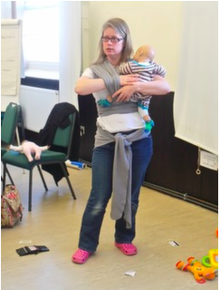 dr rosie knowles demonstrating how to use a sling